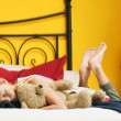 Stock Photo: Child Hugs Teddy Bear