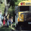 Children Loading A School Bus — Stock Photo