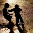 Children Pushing In Puddle — Stock Photo #31691189