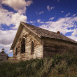 Stock Photo: Weathered Wooden Building And Church
