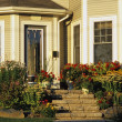 Foto de Stock  : Front Entrance Of House With Flower Garden
