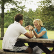 Young Couple Sitting At A Picnic Table — Stock Photo