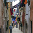 Stock Photo: Narrow PedestriStreet With Hanging Laundry