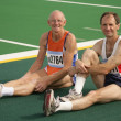 Stock Photo: Two Athletes Resting At Track