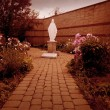 Stock Photo: Mother Mary Statue In Garden