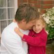 Stock Photo: Daughter Hugs Father