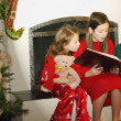 Stock Photo: Children Reading Christmas Story