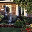 Stock Photo: Front Entrance Of Home With Flower Gardens In Foreground