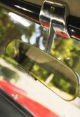 A Rear-View Mirror In A Car — Stok fotoğraf