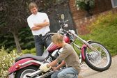 Father Watches Son Polish Motorcycle — Stock Photo