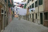 Pedestrial Street With Hanging Laundry — Стоковое фото