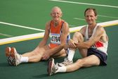 Two Athletes Resting At The Track — Stock Photo