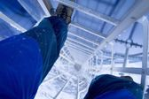 Person Climbing A Ladder At An Oil Refinery — Stock Photo