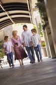Family Walking With Bibles To Church — Stock Photo