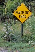 Overgrown Road Sign — Stock Photo