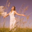 Young Woman Worshipping In A Field — Stock Photo