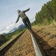 Stock Photo: WomWalking On Railroad Track