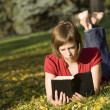 Female Reading Outdoors — Stock Photo