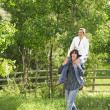 Man Carrying A Woman On Shoulders — Stock Photo