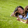 Stock Photo: Couple Laying On Grass