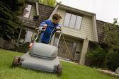 Boy Pushing Lawnmower — Stock Photo