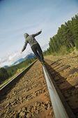 Woman Walking On Railroad Track — Stock Photo