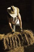Man Moving A Bale Of Hay — Stock Photo