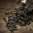 Stock Photo: Spilt Jar Of Screws