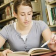 Young Woman Studying In Library — Stock Photo #31710123
