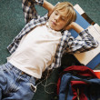 Boy Laying On Floor Listening To Music While Doing Homework — Stock Photo
