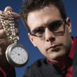 Stock Photo: MHolding Up Pocket Watch