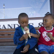 Boy And Girl Sharing Ice Cream Cone — Stock Photo #31711273