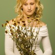 Stock Photo: Lady Looking At Wilted Flowers