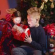 Children Opening Christmas Presents — Stock Photo
