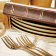 Stock Photo: Bible With Dinnerware