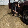 Stock Photo: MChanging Flat Tire