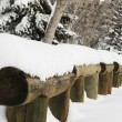 Stock Photo: Snow Piled On Log Fence