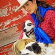 Stock Photo: Cowgirl With Two Dogs