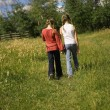 Stock Photo: Two Girls Walking In A Field