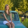 Young Woman Sitting On Hood Of Old Truck — Stock Photo #31714593