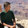 Stock Photo: Couple Looking Out At Over Canyon