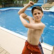 Stock Photo: Boy Showing Off His Bicep
