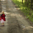 Stock Photo: Two Girls Walking Down Road