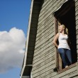Young WomIn Barn Loft — Stock Photo #31715635