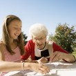 Grandmother And Granddaughter Playing A Game — Stock Photo