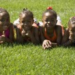 Four Girls Laying On The Grass — Stock Photo #31717315