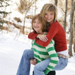 Daughter Giving Mom Piggyback — Stock Photo