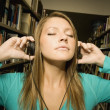 Foto Stock: Student Listening To Music