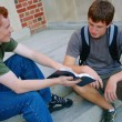 Two Young Men Sitting On Steps Discussing The Bible — Fotografia Stock  #31717905