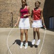 Girls Jumping Rope Together — Stock Photo #31718001